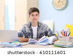 teenager sitting at table and... | Shutterstock . vector #610111601