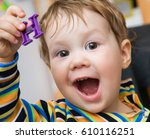 kid plays and learns toy... | Shutterstock . vector #610116251
