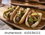 three bratwurst sausages with...   Shutterstock . vector #610136111
