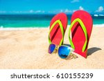 beautiful beach. beach sandals... | Shutterstock . vector #610155239