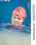 young girl learning to swim in... | Shutterstock . vector #610155734