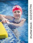 young girl learning to swim in... | Shutterstock . vector #610155794