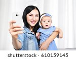 beautiful young mother and her...   Shutterstock . vector #610159145