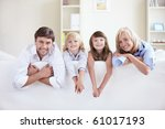 young family on a white sofa | Shutterstock . vector #61017193