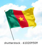flag of cameroon raised up in... | Shutterstock . vector #610209509