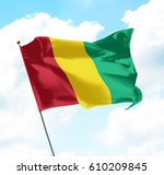 flag of guinea raised up in the ... | Shutterstock . vector #610209845