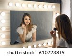 beautiful brunette woman with... | Shutterstock . vector #610223819