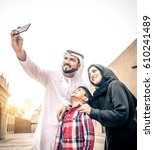 arabic family playing with child | Shutterstock . vector #610241489