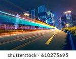 the traffic light trails of city | Shutterstock . vector #610275695