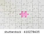 missing one piece of jigsaw...   Shutterstock . vector #610278635