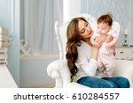 mother with baby   Shutterstock . vector #610284557