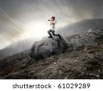 Child Using A Camera On A Rock...