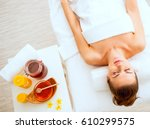 young woman laying on massage... | Shutterstock . vector #610299575