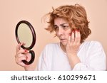 unhappy and dissatisfied middle ... | Shutterstock . vector #610299671