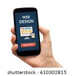 hand holding a black smart...   Shutterstock . vector #610302815
