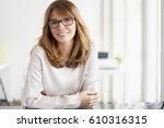 shot of a confident smiling... | Shutterstock . vector #610316315
