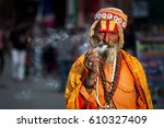an indian baba having a smoke | Shutterstock . vector #610327409