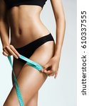 sporty woman in black lingerie... | Shutterstock . vector #610337555