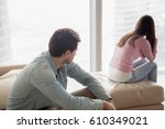 young couple sitting apart... | Shutterstock . vector #610349021