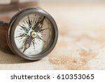 an old compass on vintage world ... | Shutterstock . vector #610353065