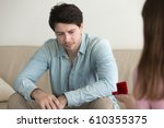 Small photo of Initiative woman making marriage proposal to boyfriend, returning box with engagement ring, asking young guy to marry, indoors, confused man looking embarrassed and puzzled, thinking what to do