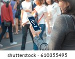 free public wifi concept.young... | Shutterstock . vector #610355495