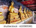the row of golden buddha in... | Shutterstock . vector #610385381
