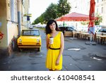cheerful woman in the street... | Shutterstock . vector #610408541