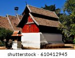 Small photo of Lampang, Thailand - December 28, 2012: Wooden Repository Library with its unique sloping roofs at Wat Phra That Lampang Luan