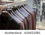 row of men's suits hanging on... | Shutterstock . vector #610421081
