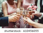 people hold in hands glasses... | Shutterstock . vector #610456055