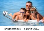 happy father with children... | Shutterstock . vector #610459067