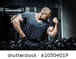bodybuilder showing off his... | Shutterstock . vector #610504019