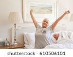senior woman sitting on her bed ... | Shutterstock . vector #610506101