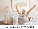 senior woman sitting on her bed ... | Shutterstock . vector #610506101