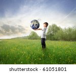 Child Holding The Earth On A...