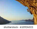 young woman climbing... | Shutterstock . vector #610526321