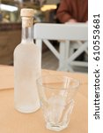 Small photo of Tsipouro with a glass with ice. Traditional frozen alcoholic beverage
