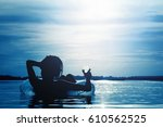 beautiful young woman with a... | Shutterstock . vector #610562525