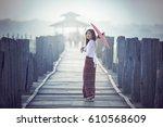 burmese woman holding... | Shutterstock . vector #610568609