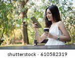 young beautiful woman holding... | Shutterstock . vector #610582319