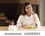 portrait of healthy woman eat... | Shutterstock . vector #610583051