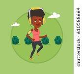 woman running with earphones... | Shutterstock .eps vector #610588664