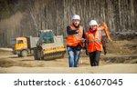 road workers inspecting... | Shutterstock . vector #610607045