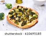 pie with broccoli and cheese on ... | Shutterstock . vector #610695185