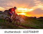 cyclist riding the mountain... | Shutterstock . vector #610706849