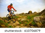 cyclist riding the mountain... | Shutterstock . vector #610706879