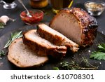 sliced barbecue meat on wooden...   Shutterstock . vector #610708301