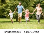 lucky family with two kids... | Shutterstock . vector #610732955