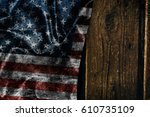 usa flag on a wood surface   Shutterstock . vector #610735109